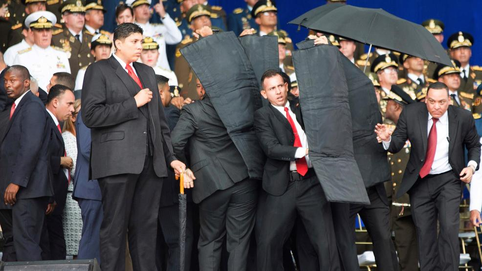 Bodyguard's respond to Maduro drone attack with ballistic shields.